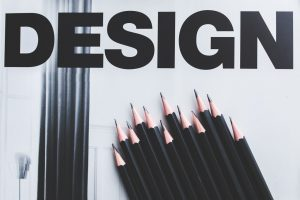 black pencils and the word design
